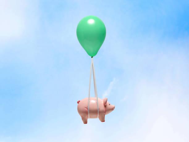 Tirelire en forme de cochon rose attachée à un ballon d'hélium vert